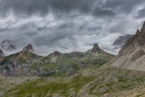 Italy, Alto Adige, Dolomites, view to Tower of Toblin and Paternkofel mountains on cloudy summer day — Stock Photo