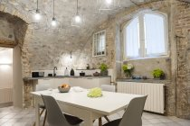 Interior of modern kitchen in old stone house — Stock Photo