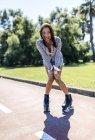 Spain, Gijon, happy teenage girl on roller skates — Stock Photo