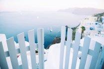Greece, Santorini, Oia, caldera with entrance gate and seascape — Stock Photo