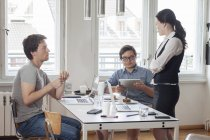 Creative business people having a meeting in a modern office — Stock Photo