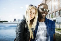 Germany, Duisburg, laughing young couple at Media Harbour — Stock Photo