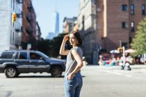 USA, New York City, woman standing on a street — Stock Photo