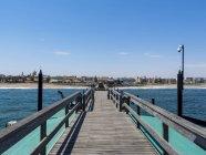 Namibia, Swakopmund, wooden pier and beach — Stock Photo