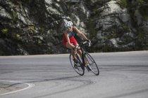Switzerland, Engadin, cyclist on Bernina Pass — Stock Photo