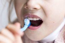Little girl brushing milk teeth — Stock Photo