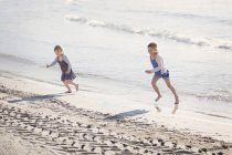 Two children playing together at seafront — Stock Photo