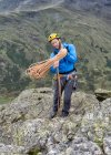 UK, Lake District, Great Langdale, climber at Pike of Stickle — Stock Photo