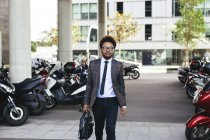 Young businessman walking outdoors — Stock Photo