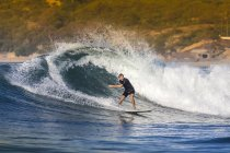 Indonesia, Lombok, surfing man in the ocean — Stock Photo