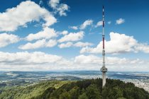 Switzerland, Zurich, Scenic view from Uetliberg with communication tower and mountain range — Stock Photo