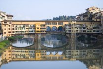 Italy, Tuscany, Florence, View to Arno River and Ponte Vecchio — Stock Photo