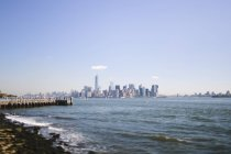 USA, New York City, view to skyline against water — Stock Photo