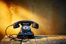 Black old bakelite telephone — Stock Photo