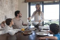 Family having lunch at dining room table — Stock Photo