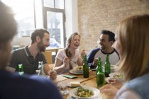 Happy friends eating together at home — Stock Photo