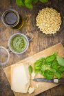 Pesto alla Genovese, Basil, parmesan, pine nuts, olive oil and raw trofie noodles — Stock Photo