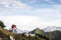 Austria, Altenmarkt-Zauchensee, young mountain biker driving at Low Tauern — Stock Photo