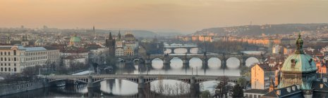 Czech Republic, Prague, cityscape with Charles Bridge at dawn — Stock Photo