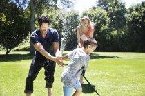 Family splashing water — Stock Photo
