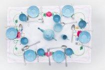 Old light blue enamel doll china set — Stock Photo