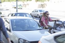 Young man on bicycle in traffic jam — Stock Photo