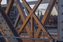 Germany, Hamburg, tower of the townhall and parts of historic warehouse district  seen through a frame bridge — Stock Photo