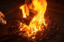 Close-up of Blacksmith forging hatchet in workshop — Stockfoto