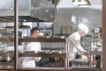 Chefs working in restaurant kitchen — Stock Photo
