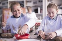 Two girls working on modeling clay in art class at school — Stock Photo