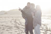 Young couple and son on the beach — Stock Photo
