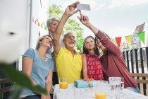 Three generations family taking a selfie on balcony — Stock Photo