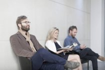 People sitting in waiting room in office — Stock Photo