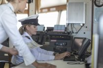 Two female deck officers on bridge of ship — Stock Photo