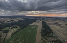 Germany, aerial view of Nothern Harz foreland at evening twilight — Stock Photo