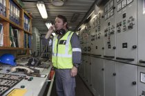 Man on telephone in control room on a ship — Stock Photo