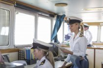 Two female deck officers on bridge — Stock Photo