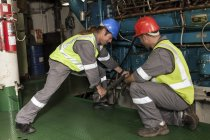 Adult caucasian crew working in engine room on a ship — Stock Photo
