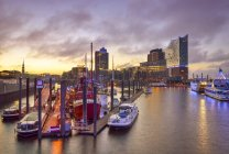Germany, Hamburg, Sunset view to harbor with Hanseatic Trade Center and  Elbphilharmonie in the background — Stock Photo