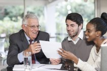 Young couple having a meeting with a salesman — Stock Photo