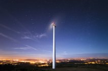 Spain, Galicia, Ferrol, Wind turbine under starry sky — Stock Photo