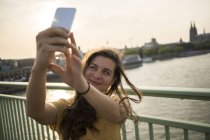 Woman taking selfie with smartphone — Stock Photo