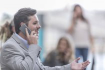 Portrait of businessman telephoning with smartphone — Stock Photo