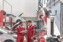Car mechanics at work in repair garage — Stock Photo