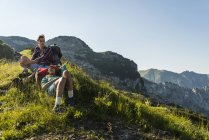 Austria, Tyrol, Young couple resting on alpine meadow — Stock Photo