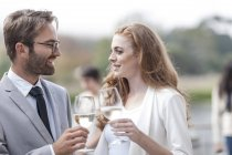 Couple toasting on terrace of a restaurant — Stock Photo