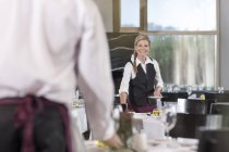 Restaurant staff setting tables in restaurant — Stock Photo