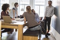 Colleagues in office having an informal meeting — Stock Photo