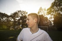 Teenager on soccer pitch looking around — Stock Photo