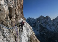 Nepal, Himalaya, Solo Khumbu, Ama Dablam South West Ridge, mountaineer climbing up rocks — Stock Photo